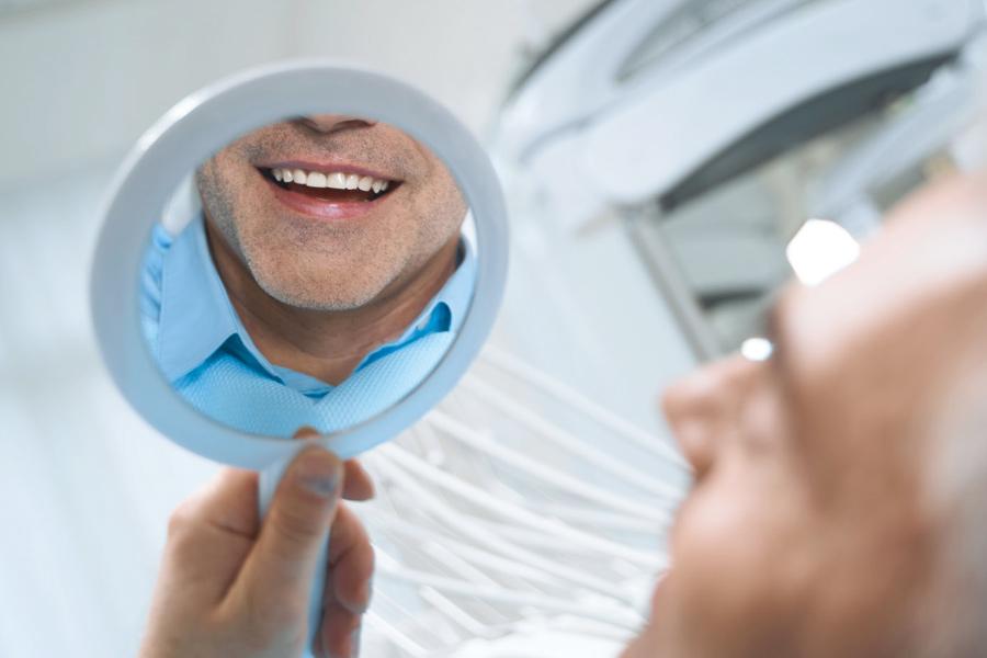 Man Smiling at Dentist